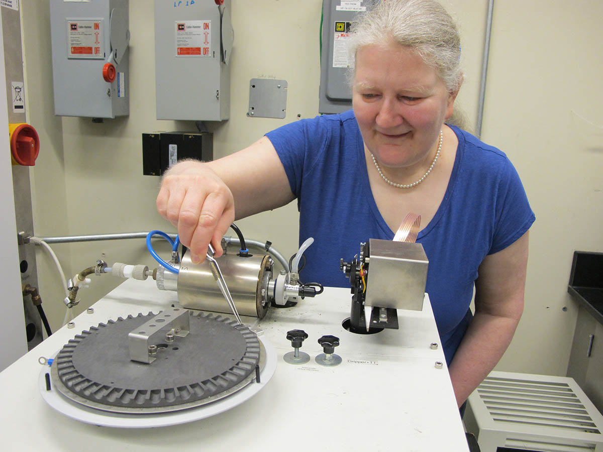 Diane Beauchemin demonstrates how she analyzes human hair in a lab