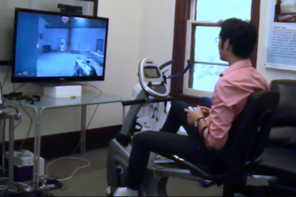 By pedaling on the exercise bike, users are able to gain in-game powerups. Dr. Nicholas Graham (Computing) and his team in the EQUIS Laboratory developed a means of modifying off-the-shelf video games to accept pedal input as a means of encouraging physical activity.