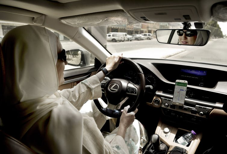 Ride-hailing services have gone global, and even women in Saudi Arabia – only recently given the right to drive – are getting in on the action. In this June 2018 photo, a female driver for Careem, a regional ride-hailing Uber competitor, is seen behind the wheel. AP Photo/Nariman El-Mofty