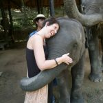 Woman hugging a baby elephant